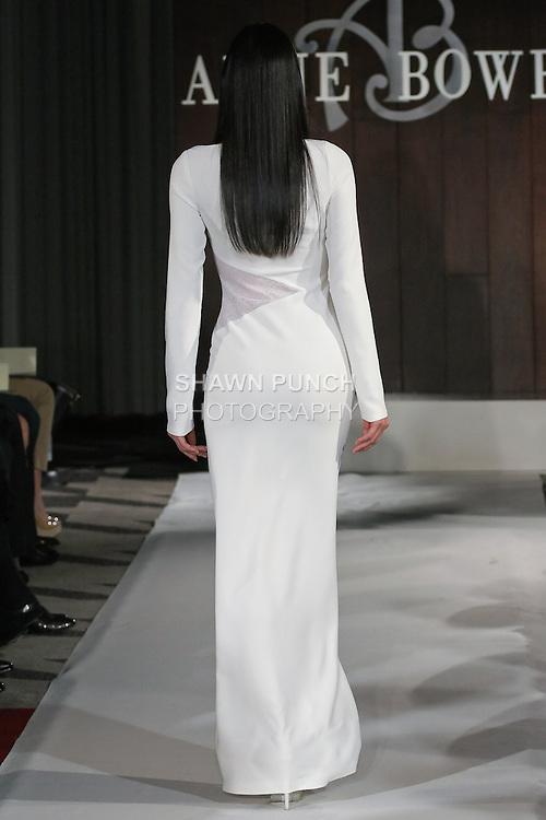 Model walks runway in a Hudson wedding dress by Anne Bowen, for the Anne Bowen Bridal Spring 2012 runway show.