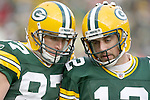 Nov 20, 2011; Green Bay, WI, USA; Green Bay Packers wide receiver Jordy Nelson (87) is thanked by quarterback Aaron Rodgers (right) after Nelson scored Green Bay's final touchdown during the game with the Tampa Bay Buccaneers at Lambeau Field. Green Bay defeated Tampa Bay 35-26. Mandatory Credit: Mary Langenfeld-US PRESSWIRE
