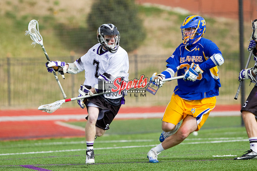 Matt Thistle (8) of the High Point Panthers is defended by Brandon Worrall (33) of the Delaware Blue Hens at Vert Track, Soccer & Lacrosse Stadium on February 2, 2013 in High Point, North Carolina.  The Blue Hens defeated the Panthers 12-10.   (Brian Westerholt/Sports On Film)