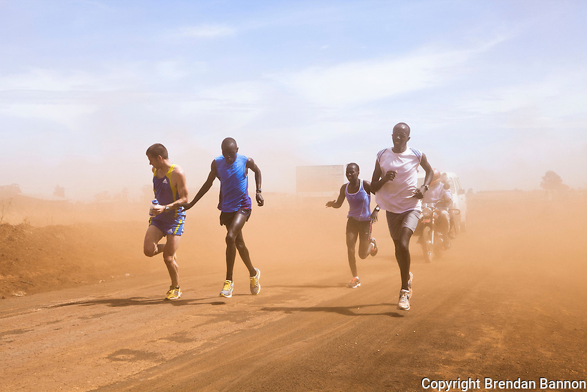 Lander Van Droogenbroeck, Simon Kosgei, Florence Kiplagat, and Shadrack Maiyo train on the dirt roads outside of Eldoret, Kenya. The high-altitude training grounds in western Kenya have  drawn athletes from around the world to train with Kenya's homegrown talent.