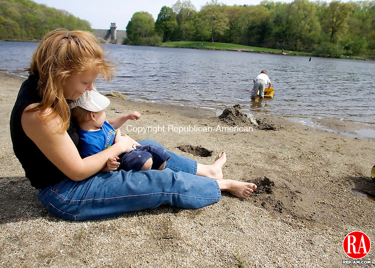 MIDDLEBURY, CT- 11 MAY 2008- 051108JT04-<br /> Natalie Chantigny, of Naugatuck, holds her son Gabriel Chantigny Vale, 2, at Hop Brook Park as her other son Nicholas Chantigny Vale, 4, loads up water into his toy truck in the background in Middlebury on Sunday, Mother's Day.<br /> Josalee Thrift / Republican-American