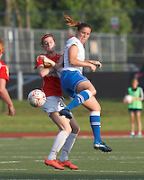 Boston Breakers defender Cat Whitehill (4) disrupts pass to Western New York forward Adriana Martin Santamaria (20). In a Women's Premier Soccer League Elite (WPSL) match, the Boston Breakers defeated Western New York Flash, 3-2, at Dilboy Stadium on May 26, 2012.