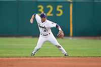 Cedar Rapids Kernels second baseman Joel Licon #41 throws during a game against the Kane County Cougars at Veterans Memorial Stadium on June 8, 2013 in Cedar Rapids, Iowa. (Brace Hemmelgarn/Four Seam Images)