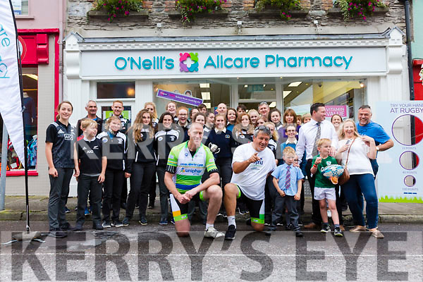 Stopping off in Cahersiveen for the on the Cross Atlantic Cycle on Monday were front l-r; Paddy Johns(Irish Rugby Union 1990 to 2000) and Zinzan Brooke(New Zealand All Blacks 1987-97) with O'Neills All Care Pharmacy staff and the Colaiste na Sceilge Rugby squad.