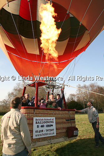 Final blasts from the propane burners and the balloon is ready to be set free, British School of ballooning, Ebernoe, West Sussex.