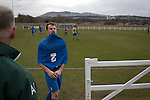 Edinburgh University 3 Selkirk 2, 13/03/2016. Peffermill, Scottish Lowland League. A visiting player removes his shirt after the final whistle as Edinburgh University took on Selkirk in a Scottish Lowland League match at Peffermill, Edinburgh in a game the hosts won 3-2. The match was one of six attended by members of GroundhopUK over the weekend to accommodate groundhoppers, fans who attempt to visit as many football venues as possible. Around 100 fans in two coaches from England participated in the 2016 Lowland League Groundhop and they were joined by other individuals from across the UK which helped boost crowds at the six featured matches. Photo by Colin McPherson.