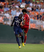 Mamadou Sakho (3) of Paris Saint-Germain FC goes up for a header with Long Tan (27) of D.C. United during the game at RFK Stadium in Washington, DC.  Paris Saint-Germain FC tied D.C. United, 1-1.