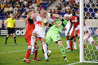 Richard Eckersley (27) and goalkeeper Stefan Frei (24) of Toronto FC battle for position with Luke Rodgers (9) of the New York Red Bulls on a free kick. The New York Red Bulls defeated Toronto FC 5-0 during a Major League Soccer (MLS) match at Red Bull Arena in Harrison, NJ, on July 06, 2011.
