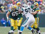 GREEN BAY, WI - NOVEMBER 30: Offenisve linemen Mark Tauscher #65 and Josh Sitton #71 of the Green Bay Packers double-team defensive lineman Damione Lewis #92 of the Carolina Panthers at Lambeau Field on November 30, 2008 in Green Bay, Wisconsin. The Panthers beat the Packers 35-31. (Photo by David Stluka)