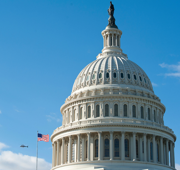 UNITED STATES - Nov 19: A helicopter flies around the U.S. Capitol Dome in support of an upcoming Architect of the Capitol construction project on Tuesday, Nov. 19, 2013.   (Photo By Douglas Graham/CQ Roll Call)
