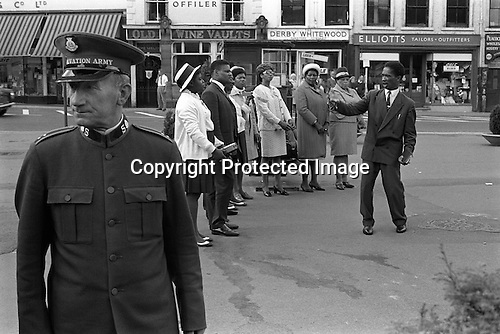 Sunday afternoon Derby town center, Derbyshire. The Salvation Arms and an afro carabbean Christian church group take it in turn to Praise the Lord. England 1970