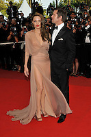ANGELINA JOLIE &amp; BRAD PITT<br /> The &quot;Inglourious Basterds&quot; Premiere at the Grand Theatre Lumiere during the 62nd Annual Cannes Film Festival, Cannes, France.<br /> May 20th, 2009<br /> full length black tuxedo suit cream beige brown pink dress sheer long wrap tattoos couple open toe shoes slit split low cut neckline profile thigh hand in pocket<br /> CAP/PL<br /> &copy;Phil Loftus/Capital Pictures /MediaPunch ***NORTH AND SOUTH AMERICAS ONLY***