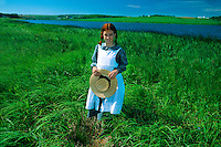 "Young girl portraying ""Anne of Green Gables"", Lake of Shining Waters, near Park Corner, Prince Edward Island, Canada"