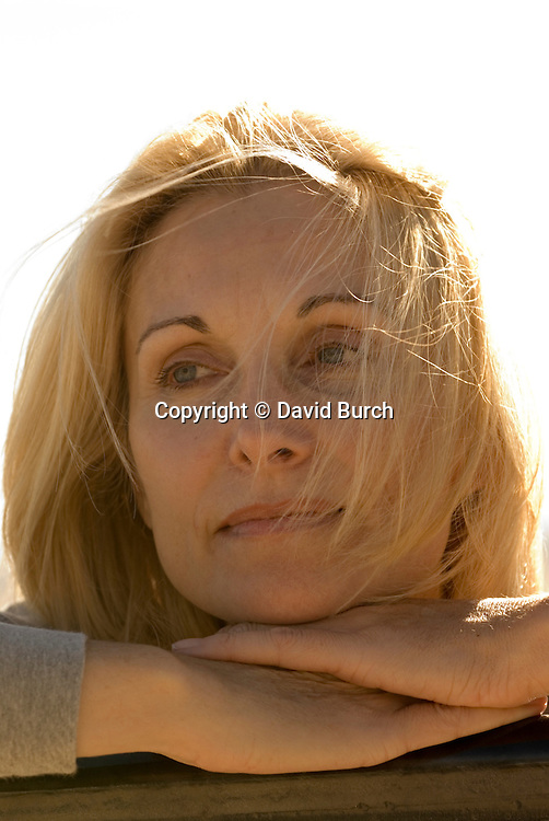Pretty blond woman contemplating