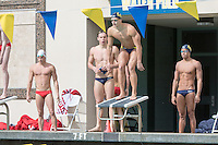 BERKELEY, CA - Feb. 18, 2017: Cal's Michael Jensen prepares to swim in the Men 200 Yard Freestyle Relay while teammates Pawel Sendyk (left) and Justin Lynch (right) look on.  Cal Men's Swimming and Diving competed against Stanford at Spieker Aquatics Complex.