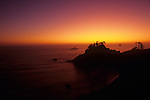 Boardman State Park Scenic Corridor with silhouetted rock formations against a dramatic sunset Southern Oregon Coast Oregon State USA