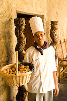 Chef with bread at Hallway of old monastry in the World Renowned Casa Santo Domingo Hotel considered best in Central America in the tourism town of Antigua Guatemal