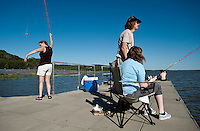 Mary Beth O'Malley (cq, left) James O'Malley (cq, middle) and Bridget O'Malley (cq, 13) fish off a dock on Lake Buchanan off Ranch Road 2341 in Hill Country near Burnet, Texas,  April 25, 2010. ..PHOTOS/ MATT NAGER