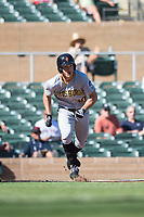Surprise Saguaros left fielder Bryan Reynolds (10), of the Pittsburgh Pirates organization, runs to first base during an Arizona Fall League game against the Salt River Rafters at Salt River Fields at Talking Stick on November 5, 2018 in Scottsdale, Arizona. Salt River defeated Surprise 4-3 . (Zachary Lucy/Four Seam Images)