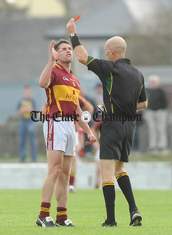 Gordon Kelly of Miltown reacts to a red card from referee Pat Cosgrove during their quarter final at Kilmihil. Photograph by John Kelly.