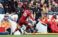 Manchester City's Riyad Mahrez threads a pass to Kyle Walker despite the attentions of Liverpool's Andrew Robertson <br /> <br /> Photographer Rich Linley/CameraSport<br /> <br /> The Premier League - Liverpool v Manchester City - Sunday 7th October 2018 - Anfield - Liverpool<br /> <br /> World Copyright &copy; 2018 CameraSport. All rights reserved. 43 Linden Ave. Countesthorpe. Leicester. England. LE8 5PG - Tel: +44 (0) 116 277 4147 - admin@camerasport.com - www.camerasport.com