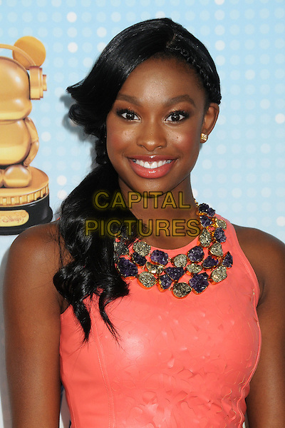 Coco Jones .At the Radio Disney Music Awards 2013 held at Nokia Theatre LA Live, Los Angeles, California, USA, .27th April 2013..portrait headshot necklace embellished stones smiling coral orange peach .CAP/ADM/BP.©Byron Purvis/AdMedia/Capital Pictures
