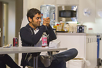 San Francisco, CA - Tuesday, July 1, 2014: Tejash Unudukt cheered after a good play by the USA in the first half. Workers watched the  USA vs. Belgium World Cup Round of 16 game at Pivotal Lab offices South of Market in San Francisco.