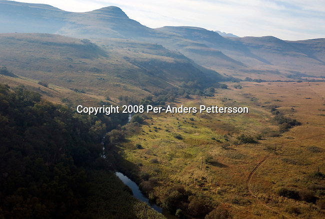 HOEDSPRUIT, SOUTH AFRICA - MAY 17: An aerial view over Blyde River Canyon, from Mariepskop, a mountain enclave with unsurpassed beauty, fauna on May 17, 2008 at Hoedspruit, South Africa. Marieskop, about 1,945m above sea level, contains well over 20,000 plants species. The area has a unique biodiversity, with savannah, forest, grass and mountains ecosystems within a 50-kilometer radius. The Kruger National Park, one of the most popular tourist attractions is nearby. (Photo by: Per-Anders Pettersson/Getty Images)..