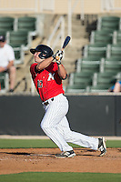 Ryan Leonards (13) of the Kannapolis Intimidators follows through on his swing against the Hickory Crawdads at CMC-Northeast Stadium on May 21, 2015 in Kannapolis, North Carolina.  The Intimidators defeated the Crawdads 2-0 in game one of a double-header.  (Brian Westerholt/Four Seam Images)