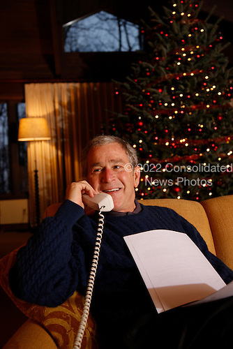 United States President George W. Bush makes his annual Christmas Eve telephone call to U.S. Armed Forces Wednesday, December 24, 2008, from Camp David, the Presidential retreat near Thurmont, Maryland.  .Mandatory Credit: Eric Draper / White House via CNP.