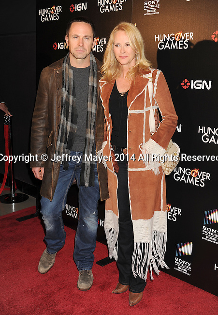 HOLLYWOOD, CA- FEBRUARY 11: Actors William deVry (L) and Rebecca Staab attend the Los Angeles Premiere of 'The Hungover Games' at TCL Chinese Theatre on February 11, 2014 in Hollywood, California.