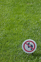 Warning sign on a grassy lawn, Summer Palace, Beijing, China.