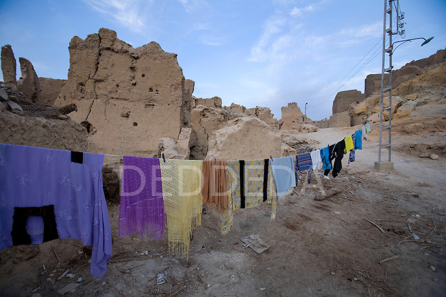 A clothesline of drying clothing, set within the walls of the 13th century mud-brick fortress of Shali, in Siwa Town of the Siwa Oasis, near the Libyan border in Egypt.