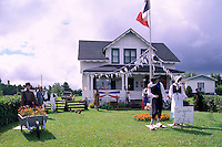Bertrand, NB, New Brunswick, Canada - House decorated with Acadia Colours (Blue, White, and Red / Bleu, Blanc, Rouge) and Iconic Figures, for the Annual Acadian Festival