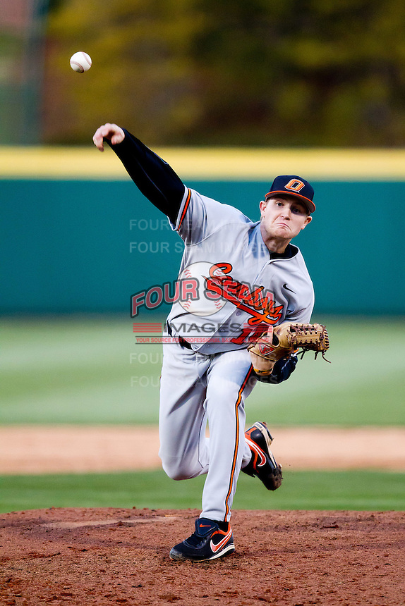 Phillip Wilson (14) of the Oklahoma State Cowboys delivers a pitch during a game against the Missouri State Bears at Hammons Field on March 6, 2012 in Springfield, Missouri. (David Welker / Four Seam Images).