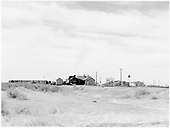 D&amp;RGW #497 setting out cars at Mosca.  Section house and town buildings nearby.<br /> D&amp;RGW  Mosca, CO  Taken by Richardson, Robert W. - 1950