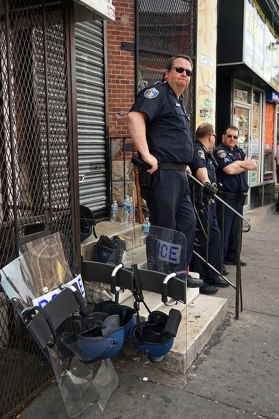 Police officers cast a watchful eye on the scene of the riots during a lull. April 30, 2015. to go with Nick O'Malley story.  photo by Trevor Collens