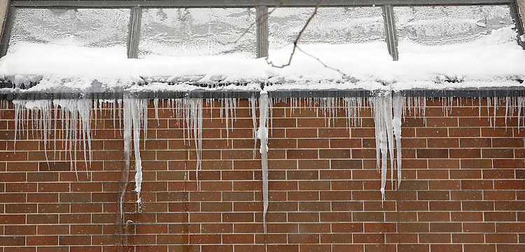 Icicles hang from the Schmitt Academic Center on the Lincoln Park campus of DePaul University in Chicago as the New Year brought two days of lake effect snow and ice. (Photo by Jamie Moncrief)
