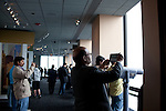 People take pictures with tablet computers, cell phones and cameras from the Skydeck at the Willis Tower, Chicago, IL