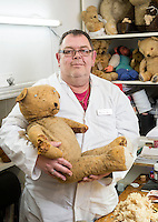 BNPS.co.uk (01202 558833)<br /> Pic: PhilYeomans/BNPS<br /> <br /> 'Dr' Dave Taylor with one of their patients.<br /> <br /> Broken bears and deteriorating dolls from all over the world are being brought back to life by a UK team of dedicated doctors and nurses at one of the last remaining toy hospitals.<br /> <br /> The team at Alice's Bear Shop, a teddy bear and doll hospital in Lyme Regis, Dorset, perform all kinds of 'surgery' from simple restringing and re-stuffing to head re-attachments and complete skin grafts.<br /> <br /> Rikey Austin, 49, opened the hospital in January 2000 but also ran a shop and only repaired one or two toys a month.<br /> <br /> Now she has a four-month waiting list for patients and has had to close the shop to focus on the hospital side of the business.
