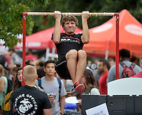 NWA Democrat-Gazette/MICHAEL WOODS &bull; @NWAMICHAELW<br /> University of Arkansas senior Eric Dredgers, from Barling, tests his pull up ability at the Marine Corps information booth Thursday August 27, 2015 during Razorbash at the University of Arkansas.  The annual event has more than 200 booths featuring local businesses, community groups, campus departments, and registered student organizations giving away free food, prizes and information to students attending the event.  Razorbash offers students an opportunity to connect with the local community and organizations that suit their interests and