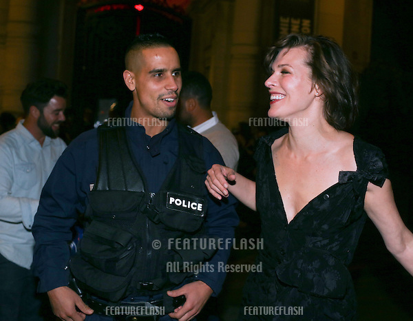 PARIS, FRANCE - JULY 05:  Milla Jovovich poses with french police officers after the Vogue Foundation Gala 2016 <br /> July 5, 2016  Paris, France<br /> Picture: Kristina Afanasyeva / Featureflash