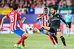 Isco Alarcon (r) of Real Madrid battles for the ball with Thomas Teye Partey of Atletico de Madrid during their 2016-17 UEFA Champions League Semifinals 2nd leg match between Atletico de Madrid and Real Madrid at the Estadio Vicente Calderon on 10 May 2017 in Madrid, Spain. Photo by Diego Gonzalez Souto / Power Sport Images