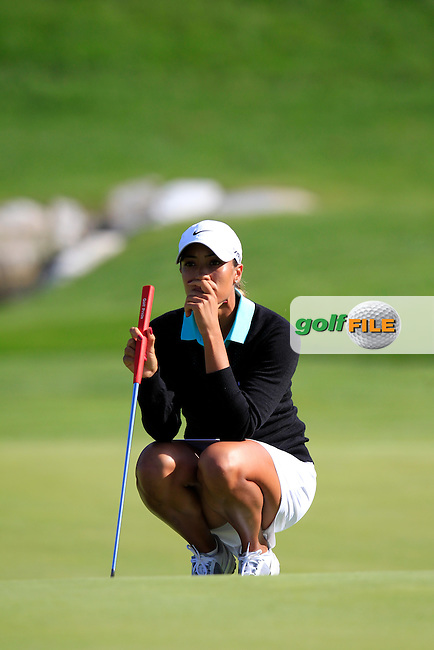 Cheyenne Woods (USA) lines up her putt on the 18th green during Friday's Round 2 of The Evian Championship 2014 held at the Evian Resort Golf Club, Evian-les-Bains, France.: Picture Eoin Clarke, www.golffile.ie: 12th September 2014