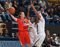California defenders Afure Jemerigbe and Courtney Range try to block Oregon State's Ali Gibson attempts to pass the ball at Haas Pavilion in Berkeley, California on January 3rd, 2014.  California defeated Oregon State, 72-63.
