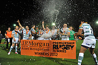 Champagne flies as London Irish celebrate winning the J.P. Morgan Premiership Rugby 7s Series. J.P. Morgan Premiership Rugby 7s, on August 3, 2012 at the Recreation Ground in Bath, England. Photo by: Patrick Khachfe / Onside Images