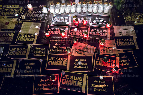Signs and candles lay on the ground to show support for the terrorist attack victim staff of the Charlie Hebdo satirical weekly in front of the French Embassy in Budapest, Hungary on January 09, 2015. ATTILA VOLGYI