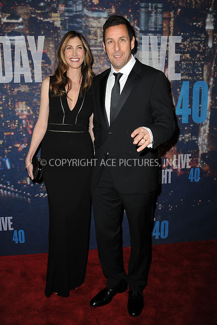 WWW.ACEPIXS.COM<br /> February 15, 2015 New York City<br /> <br /> Jackie Sandler and Adam Sandler walking the red carpet at the SNL 40th Anniversary Special at 30 Rockefeller Plaza on February 15, 2015 in New York City.<br /> <br /> Please byline: Kristin Callahan/AcePictures<br /> <br /> ACEPIXS.COM<br /> <br /> Tel: (646) 769 0430<br /> e-mail: info@acepixs.com<br /> web: http://www.acepixs.com