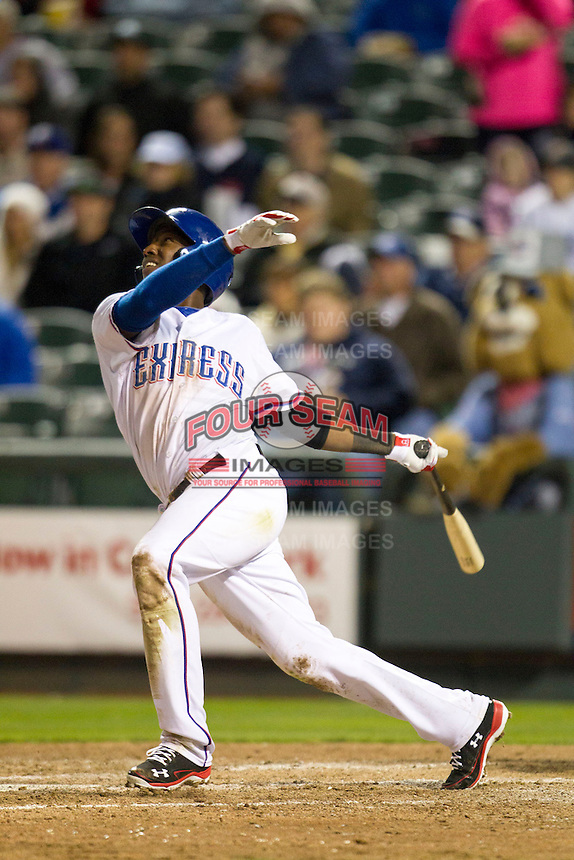 Round Rock Express shortstop Jurickson Profar #10 follows through on his swing against the Omaha Storm Chasers in the Pacific Coast League baseball game on April 4, 2013 at the Dell Diamond in Round Rock, Texas. Round Rock defeated Omaha in their season opener 3-1. (Andrew Woolley/Four Seam Images).