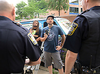 DOYLESTOWN, PA - JULY 08:  Mike Randazzo (C), 29, of Media, Pennsylvania speaks with Central Bucks Regional Police officers as Edward Forchion of Pemberton, New Jersey (2nd from left) looks on during a protest for a Bucks County defendant charged with marijuana possession July 8, 2014 in Doylestown, Pennsylvania.  (Photo by William Thomas Cain/Cain Images)